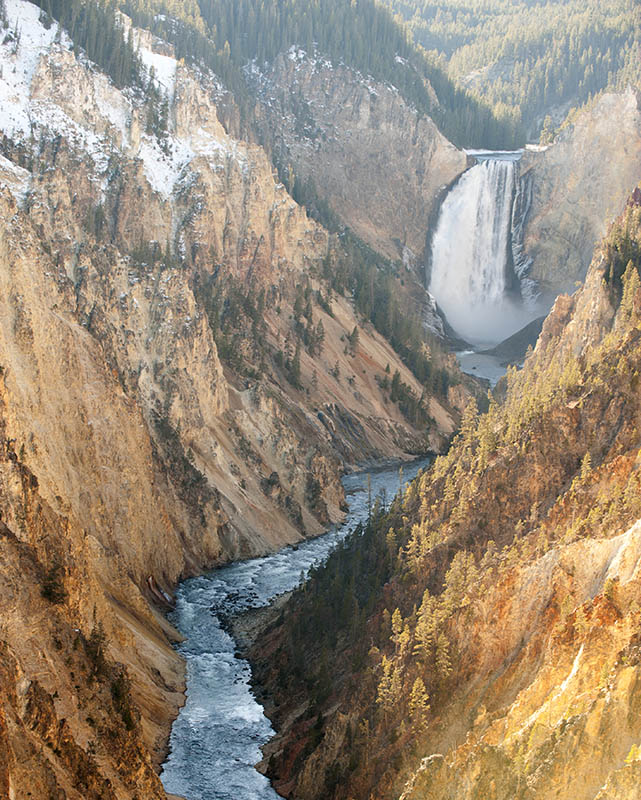 Snow and ice cover the walls of the Grand Canyon of Yellowstone below Lower Falls.