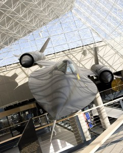 An SR-71 Blackbird hangs in the lobby of the Strategic Air and Space Museum.